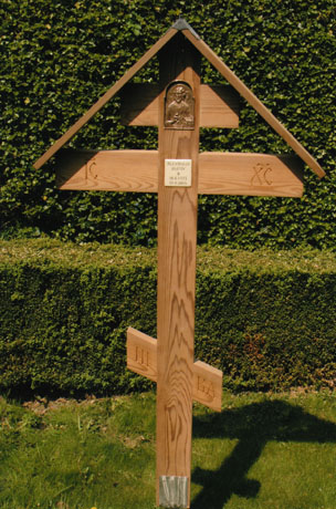 Grave cross, with bronze relief icon