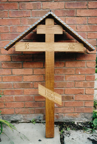 Simple grave cross.